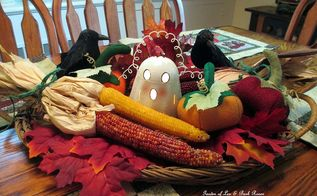 felt pumpkins in a halloween centerpiece, crafts, halloween decorations, home decor, seasonal holiday decor, Here s my Halloween centerpiece with Dollar Store ghost leaves and crows some Indian Corn and three hand sewn felt pumpkins http pinterest com barbrosen our fairfield home
