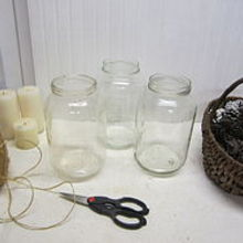 old pickle jars upcycled into pottery barn knockoffs, christmas decorations, repurposing upcycling, seasonal holiday decor, Using twine I had on hand I began wrapping it around the neck of a wide mouthed gallon size pickle jar I glued it periodically with a hot glue gun as I wrapped it around the jar