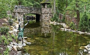 no this is not a moat this is a large reflection pond for our client on the, outdoor living, ponds water features, spas, Large pond with stone bridge and turret with awesome reflection built on Long Island by Deck and Patio Company