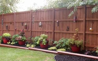outdoor landscape, fences, gardening, landscape, outdoor living, After Backyard Fence w Lanterns Red Pots