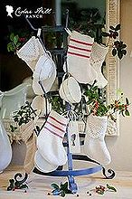 mini grainsack stockings, christmas decorations, crafts, seasonal holiday decor, mini grain sack stockings on French bottle drying rack