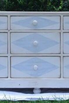 painted dresser with harlequin diamonds and compass roses, painted furniture, A straight on shot of the painted dresser Antique white base with pale blue diamonds The drawers were simple with no embellishments and plain wooden knobs so the diamonds worked they had no competition