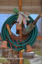 a garden hose wreath, home decor, wreaths, A garden hose small terracotta pots and gloves for a bow