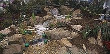 wizard of oz garden with ponds and water features, gardening, outdoor living, ponds water features, A beautiful pondless waterfall enhances the way to Oz