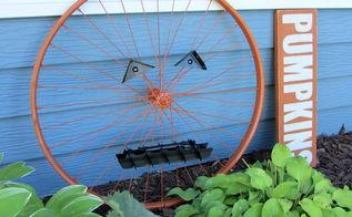 an up cycled bicycle wheel garden pumpkin, crafts, repurposing upcycling, seasonal holiday decor