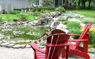 25 dreamy outdoor spaces, outdoor living, Red Adirondack chairs by the pond