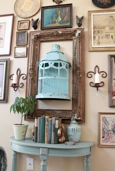 adding aqua, home decor, painted furniture, Full shot of the aqua birdcage and painted side table This is my gallery wall put together entirely of yardsale and thriftstore items