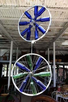 bicycle wheel wonderfulness, gardening, repurposing upcycling, How did they attach these bottles to the bike rims Does anyone know