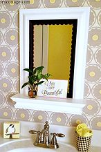 add detail with scalloped trim easy mirror makeover, bathroom ideas, crafts, home decor, Stratford wall mirror with shelf from wayfair com with the added trim