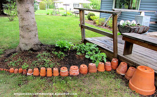 making a terra cotta pot flower bed edging, flowers, gardening, perennials, I like the idea of lining them up smallest to largest but they could be all the same size too