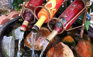 wine bottle fountain, gardening, I think I m seriously going to try to make one of these I mean I m going to make one of these
