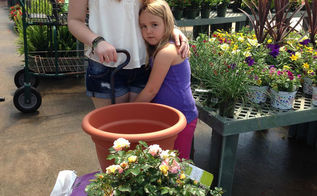 kids plant a drift rose for mom, container gardening, flowers, gardening, The girls choosing Apricot Drift for Mom