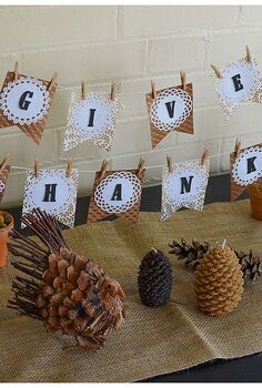 thanksgiving diy banner, crafts, seasonal holiday decor, thanksgiving decorations, Scatter pine cones around the table followed by a few candles and any thanksgiving decor you may have I added two cute little turkeys I found at Target