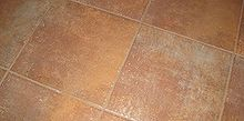 installing state tile flooring in laundry room, home decor, laundry rooms, tile flooring, tiling