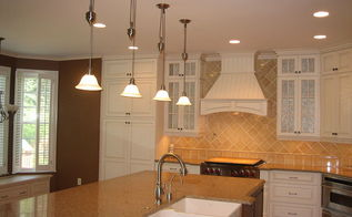luxury farmhouse chic kitchen, home decor, kitchen design, kitchen island, Furniture base toe kick shoe molding pilasters at range and sink and fillers per design and decorative hood wood top for window seat cabinets bead board on the back of the island end units were all built with custom cabinetry