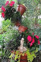 happy mother s day garden tour, gardening, Tipsy Pots planted with Euphorbia New Guinea Impatiens Lobelia and Creeping Jenny