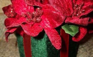 crafty christmas bouquets for teachers, christmas decorations, crafts, seasonal holiday decor, A Dollar store velvet gift box and velvet poinsettia sprigs Just simply glue the florist foam on the bottom of the inside of the box Cut to fit the sprigs in the foam then glue them in making the arrangement Done