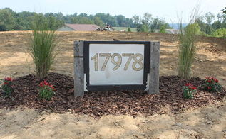 making a unique address sign from an old window, home decor, repurposing upcycling, The new address sign at the front entrance For now we planted some grasses later on we will add more stone and landscaping