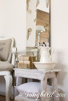 how to alter a mirror and give it an vintage weathered look, crafts, painted furniture, With bits of paper peeping through the mirror this mirror looks aged warn and beautiful