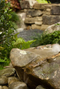 photos of our garden at the southeastern flower show, flowers, gardening, outdoor living, The bubbling rock feature It is a real fieldstone boulder that had the perfect shape We drilled the rock to create this feature