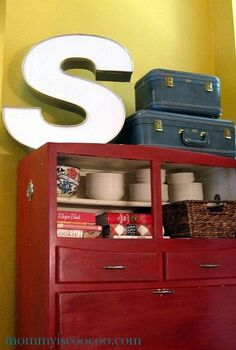 how i used an old bakers cabinet to get my family organized, kitchen cabinets, organizing, Vintage letter S with old suitcases on a baker s cabinet