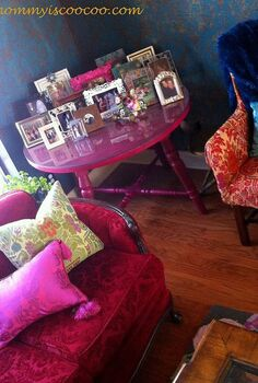 creating eclectic which is kind of coocoo style tips and ideas, home decor, I love a table full of pictures This antique table painted hot pink is perfect for the corner
