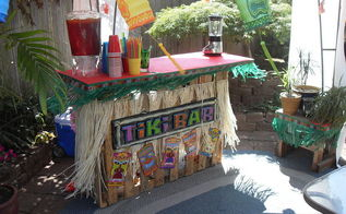 building a tiki bar from pallets, pallet, After decorations lookin good