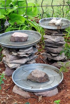 stacked stone bird baths, outdoor living, repurposing upcycling, Stone leftover from another project and three galvanized trash can lids become a bird bath grouping Another of my use what you have ventures More pictures and directions at