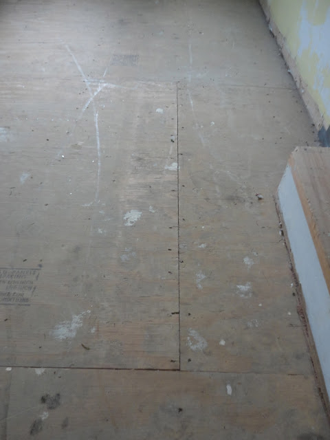 I painted my awful underlayment to look like hardwood for Painting vinyl floor tile