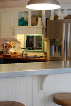 white kitchen, home decor, kitchen design, We had a slipcover made for the bar from galvanized steel by a company that makes commercial range hoods It is just slid in place over the old formica top and can be easily removed if I ever wanted to change it