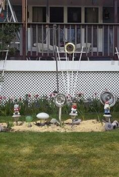 mushrooms flowers and gnomes oh my, flowers, gardening, The whole scene with 4 recycled flowers 3 mushrooms and 4 gnomes 3 of which are Nebraska fans The other one is Army of course