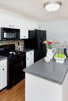 kitchen cabinet makeover on a budget, home decor, kitchen backsplash, kitchen design, Painted kitchen cabinets using Sherwin Williams Pure White