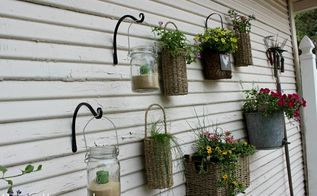 cottage garden landscaping, flowers, gardening, outdoor living, Close up of the baskets filled and the jars with sand and candles