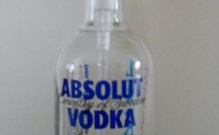 i upcycle an absolut vodka bottle into a soap dispenser and stamped the name, repurposing upcycling, front view