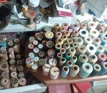 q old thread, crafts, Empty wooden thread spools on the left new and old thread on the right