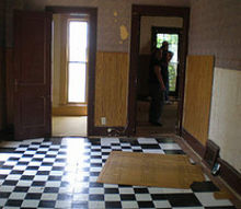 upstairs living room, hardwood floors, home improvement, Self stick black and white tiles over the most beautiful hardwoods I ve ever seen I ll never understand it It was a mess getting them up the sander did most of the work though and in the end the floors turned out good