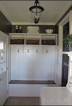 adding a mudroom to our garage, garages, home improvement, laundry rooms, Custom shelving and shoe storage bench The black door to the right leads to the kitchen The door on the left leads to the garage