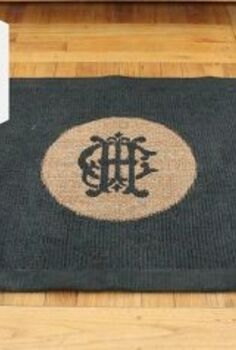 make an old rug look new for just a few dollars, repurposing upcycling, This is the same rug All I did was give it a few coats of black paint and kept the center plain so our custom made monogram would really stand out