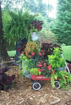 repurposed junk garden, gardening, repurposing upcycling, Radio flyer wagon washtub and an old heater repurposed as a plant stand
