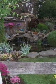 landscaping, outdoor living, ponds water features, This photo was taken just as evening was coming on I m not a photographer but this turned out really great I entered the picture at the fair but a cat took 1st and a skyscraper took 2nd oh well