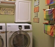 the small laundry dilemma, laundry rooms, I think some handles or knobs for the cabinets