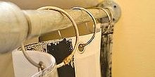 make a pedestal sink skirt from a shower curtain, bathroom ideas, crafts, diy, home decor, how to, These are the shower curtain rings that hang the skirt We had extra around but you could find a more decorative style at Target or your own favorite decor store