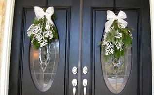 adding winter greens, home decor, seasonal holiday decor, wreaths, I topped the swags off with a simple mesh bow