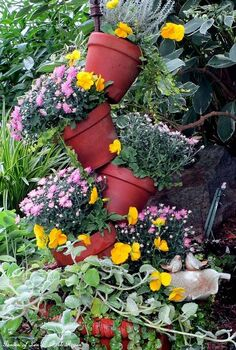 fall tipsy pots planter, gardening, Just updated the spring tipsy pots planter for fall by adding fall pansies small mums plectranthus and a little curry plant See more pictures at