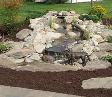 aquascape pondless and ephenry paver patio with fire pit, concrete masonry, landscape, outdoor living, ponds water features, Aquascape s Naughty dog fountain spitter adds a cute little giggle