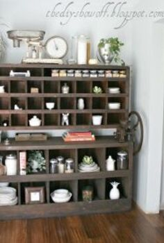 we re in the process of transforming our kitchen on a budget to fit our style we, home improvement, kitchen backsplash, kitchen design, kitchen island, I love this old chunky piece as use as a Butler s pantry Storage for good dishes cookbooks and spices