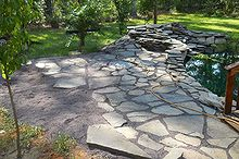 flagstone patio, concrete masonry, outdoor living, patio, ponds water features, pond patio being built