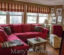 have a home you ll love on a budget home tour from marty s musings, home decor, Our den makeover with Pergo flooring and a fun red sectional