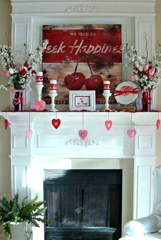 our 2013 valentine mantel, seasonal holiday d cor, valentines day ideas, Here is our Seek Happiness Valentine mantel I found the fun vintage y canvas on sale at World Market truly an unexpected purchase and thought that it would be a fun focal point for our holiday mantel
