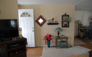 q living room wall ideas, home decor, living room ideas, wall decor, With the door open from my chair tv on left little wall and at the right end of picture is the main living room wall So I don t think it looks so unbalanced from my chair But I agree adjust the mirror at least